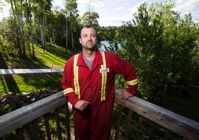 Gregoire Lake Estates, AB.-- Rheimer Reid at Gregoire Lake Estates on May, 31 2016 . Rheimer stayed at his home during the fire to help protect his home as well as his neighbours in the subdivision. (Greg Southam-Edmonton Journal)