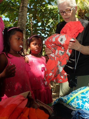 Volunteer Joyce Hurl helps some patients find some goodies after they'd had some work done at a Change for Children dental clinic set up in the village of San Andres in Nicaragua's Bosawas Biosphere Reserve in February 2016. (Max Maudie photo)
