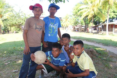 A group of kids takes a break from kicking the ball around in the village of San Andres in Nicaragua's Bosawas Biosphere Reserve in February 2016. A Change for Children dental clinic had been set up in the village. (Max Maudie photo)