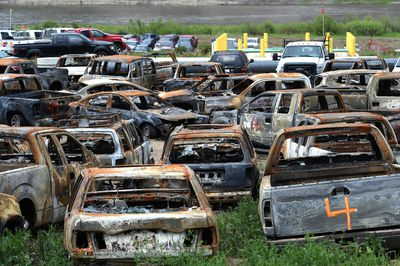 FORT MCMURRAY, ALTA: JUNE 1, 2016 -- The burnt-out vehicle grave yard at the municipal impound lot in Fort McMurray, June 1, 2016. All the vehicles destroyed by the wildfire will be hauled here. (ED KAISER/PHOTOGRAPHER)