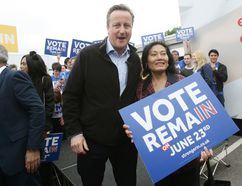 British Prime Minister David Cameron poses with a campaigner as he makes a joint appearance with Mayor of London Sadiq Khan (not seen) to launch the Britain Stronger in Europe guarantee card at Roehampton University on May 20, 2016 in London, United Kingdom. The 'guarantee card' lists five pledges should Britain remain in the EU, including the protection of workers' rights, full access to the single market and stability for Britain. U.K voters go to the polls on June 23 to vote in a referendum on the continued membership of the UK in the European Union. (Photo by Yui Mok - WPA Pool/Getty Images)