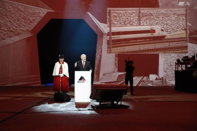 Swiss Federal President Johann Schneider- Ammann, speaks on the opening day of the Gotthard rail tunnel,  at the fairground Rynaecht at the northern portal in Erstfeld, Switzerland, Wednesday, June 1, 2016. The construction of the 57 kilometer long tunnel began in 1999, the breakthrough was in 2010. After the official opening on June 1, the commercial operation will  start in December 2016. (/Peter Klaunzer/Pool Photo via AP)