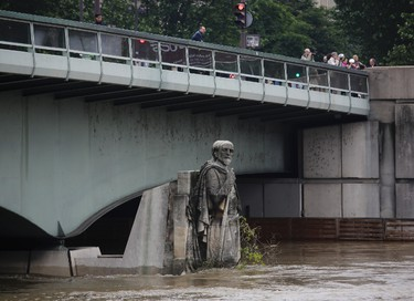 The Zouave statue at the bridge Pont de l'Alma which serves as a measuring instrument for water levels during floods, is partly overflowing by the river Seine in Paris, Thursday, June 2, 2016. Floods are inundating parts of France and Germany as rivers have broken their banks from Paris to Bavaria. (AP Photo/Markus Schreiber)