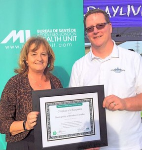 Mayor Joanne Vanderheyden and Rob Lilbourne, head of the recreations department for Strathroy-Caradoc, received the award on behalf of the municipality during a ceremony on Tuesday, May 31, at the St. Julien Park in London. Photo taken from the municipality's Facebook page.