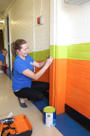Courtney Rieck from Great Northern Insulation touched up the neon colours at the Fusion Youth Centre in Ingersoll during the United Way's Day of Caring on Thursday, June 2, 2016. (MEGAN STACEY/Sentinel-Review)