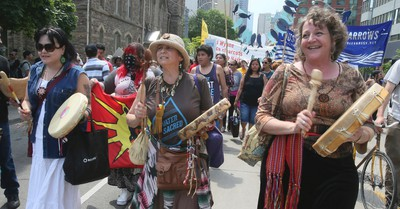 Hundreds gathered at Queens Park and marched to Allan Gardens on Thursday June 2, 2016. Grassy Narrows First Nation and neighbouring communities are requesting  the clean up of the Wabigoon River after a paper mill dumped toxic waste into the river, which opened 45 years ago. The residents insist that they suffer from debilitating health issues resulting from unhealthy drinking water. Veronica Henri/Toronto Sun/Postmedia Network