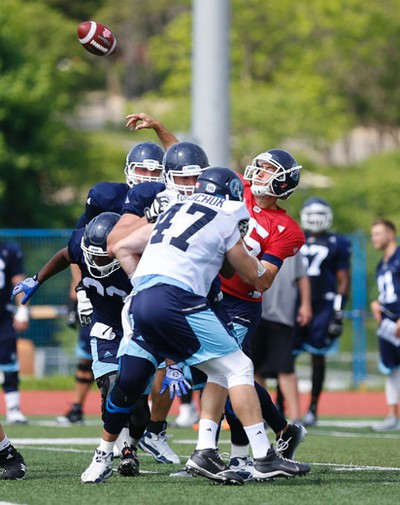 Toronto Argonauts Ricky Ray QB (15) fires off a pas to a receiver  during practice in Guelph, Ont. on Thursday June 2, 2016. Jack Boland/Toronto Sun/Postmedia Network