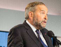 NDP leader Tom Mulcair speaks to reporters during a press conference following the first federal leaders debate of the 2015 Canadian election campaign in Toronto, August 6, 2015. (AFP PHOTO / GEOFF ROBINS (Photo credit should read GEOFF ROBINS/AFP/Getty Images)