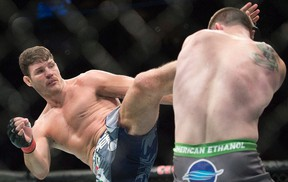 Michael Bisping (left) has fashioned a profitable UFC career as a flamboyant English bad boy, yet he had never been given a title fight after 25 trips to the octagon. Thanks to Chris Weidman's late injury, Bisping finally gets his long-awaited shot at middleweight champion Luke Rockhold's belt at UFC 199 on Saturday in Los Angeles. (Graham Hughes/AP Photo/Files)