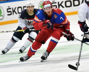 Ivan Telegin, seen here during the recent world hockey championships, will be staying in the KHL next season. (AFP FILE PHOTO/ALEXANDER NEMENOV)
