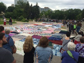 More than 100 people rallied at the Legislature on the one-year anniversary of the release of the Truth and Reconciliation Commission report.  (David Larkins/Winnipeg Sun/Postmedia Network)