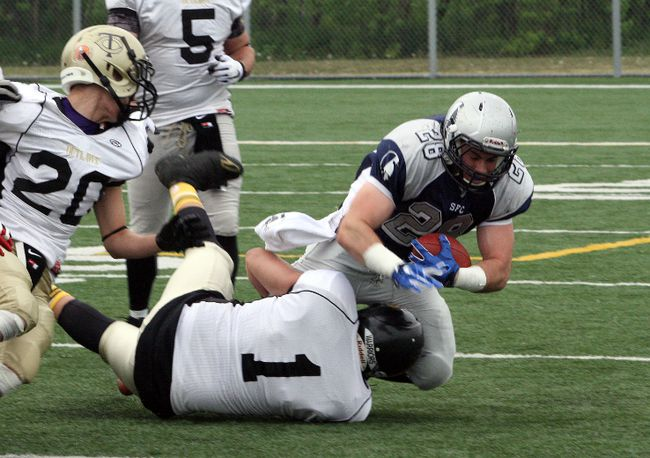 Sudbury Spartans running back Josh Cuomo is tackled as he rushes the ball during a Northern Football Conference game against the Tri-City Outlaws on Saturday. Ben Leeson/The Sudbury Star/Postmedia Network