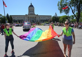 Participants carry the rainbow flag during the Pride parade in Winnipeg earlier this month. (Brian Donogh/Winnipeg Sun file photo)