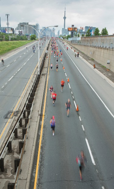Cyclists and runners in the Heart and Stroke Foundation's 29th Annual Becel Heart&Stroke Ride for Heart along the Gardiner Expressway as seen from the Dufferin Bridge in Toronto, Ont. on Sunday June 5, 2016. This year the event added a 5km/10km run and 5km walk. Ernest Doroszuk/Toronto Sun/Postmedia Network