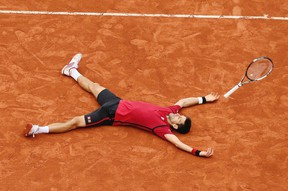 Serbia's Novak Djokovic falls as he defeats Britain's Andy Murray during their final match of the French Open tennis tournament at the Roland Garros in Paris on June 5, 2016. (AP Photo/David Vincent)
