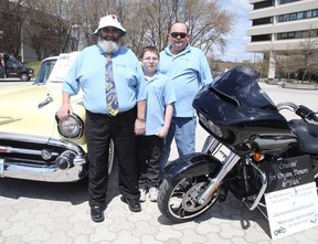 Ward 3 Coun. Gerry Montpellier, left, poses with Bob Johnston, an organ recipient, and son Bob Jr. The group was promoting the first Cruising for Organs and Rich fundraiser on June 12. Participants will drive classic cars and motorcycles around the city to encourage organ donation and raise money for local people who must travel for transplants. (Gino Donato/Sudbury Star)