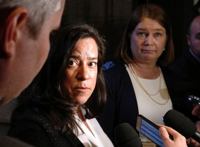Minister of Justice Jody Wilson-Raybould and Health Minister Jane Philpott, right, talk to reporters outside the House of Commons on Tuesday May 31, 2016 in Ottawa. Wilson-Raybould likes to cite the case of E.F. when she warns of the danger that will exist as of 12:00 a.m. Monday, when medically assisted dying becomes legal in Canada without safeguards. THE CANADIAN PRESS/Fred Chartrand