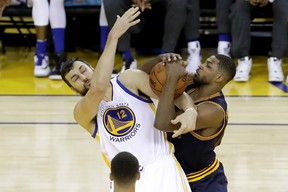 Andrew Bogut of the Golden State Warriors and Tristan Thompson of the Cleveland Cavaliers fight for a rebound in Game 2 of the NBA Finals at ORACLE Arena in Oakland on June 5, 2016. (Ronald Martinez/Getty Images/AFP)