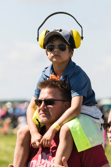 Jamie Lbrosse and his son, Joshua, check out the 2016 Manitoba Air Show in Portage-Southport, Man., on Saturday, June 4, 2016. (Brook Jones/Postmedia Network)