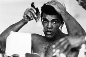 """This photo taken on October 19, 1974 shows US boxing heavyweight champion Muhammad Ali 11 days before he knocked out George Foreman in a clash of titans known as the """"Rumble in the Jungle."""" Earlier that year, Ali spoke at a fundraising dinner in Sarnia, as a last-minute replacement. (AFP PHOTO)"""