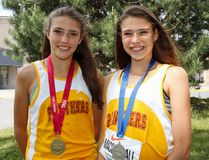 Brogan MacDougall, left, won gold in the junior girls 3,000 metres and older sister Branna won silver in the senior girls 3,000 metres at the Ontario Federation of School Athletic Associations track and field championships in Windsor on the weekend. (Julia McKay/The Whig-Standard)