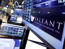 In this March 15, 2016 file photo, a trading post on the floor of the New York Stock Exchange displays the Valeant Pharmaceuticals logo. Valeant Pharmaceuticals saw its stock tank Tuesday to its lowest level in nearly six years after the Quebec-based drug giant slashed it outlook for the year and reported disappointing first-quarter results. THE CANADIAN PRESS/AP/Richard Drew