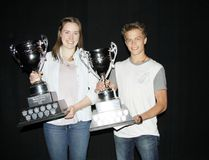 <p>Canmore Collegiate High School female athlete of the year Tillie Heighington and male athlete of the year Zack Waldbauer pose with their trophies following Knight of Honur celebrations at the school on Tuesday, May 31, 2016. Russ Ullyot/ Bow Valley Crag & Canyon/ Postmedia Network