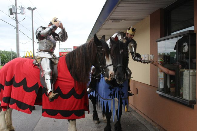 <p>Several Knights of Valour on their way to the Upper Canada Village annual Medieval Festival this weekend, made a promotional stop in Cornwall on Wednesday afternoon, jousting for positioning at the pickup window to collect meals fit for kings, on Wednesday, June 8, 2016.Todd Hambleton/Cornwall Standard-Freeholder/Postmedia Network