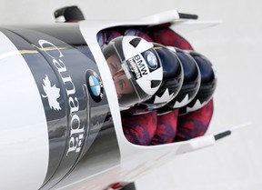 Driver Justin Kripps with Alexander Kopacz, Derek Plug and brakeman Ben Coakwell compete in the four-man bobsled World Cup race in Lake Placid, N.Y., on Jan. 9, 2016. Kripps, along with fellow bobsledder Chris Spring, are using the game of golf to improve their mental strength. (Mike Groll/AP Photo)