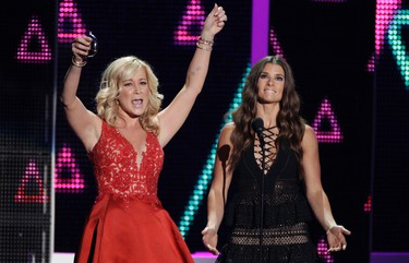Kellie Pickler, left, and Danica Patrick present the award for male video of the year at the CMT Music Awards at the Bridgestone Arena on Wednesday, June 8, 2016, in Nashville, Tenn. (Photo by Wade Payne/Invision/AP)