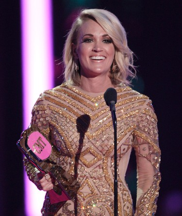 Carrie Underwood accepts the award  for CMT performance of the year for 'Smoke Break' at the CMT Music Awards at the Bridgestone Arena on Wednesday, June 8, 2016, in Nashville, Tenn. (Photo by Wade Payne/Invision/AP)