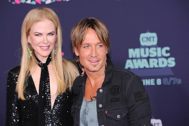 Nicole Kidman, left, and Keith Urban arrive at the CMT Music Awards at the Bridgestone Arena on Wednesday, June 8, 2016, in Nashville, Tenn. (Photo by Sanford Myers/Invision/AP)