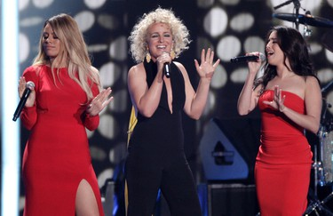 Dinah Jane, from left, Cam, and Lauren Jauregui perform at the CMT Music Awards at the Bridgestone Arena on Wednesday, June 8, 2016, in Nashville, Tenn. (Photo by Wade Payne/Invision/AP)