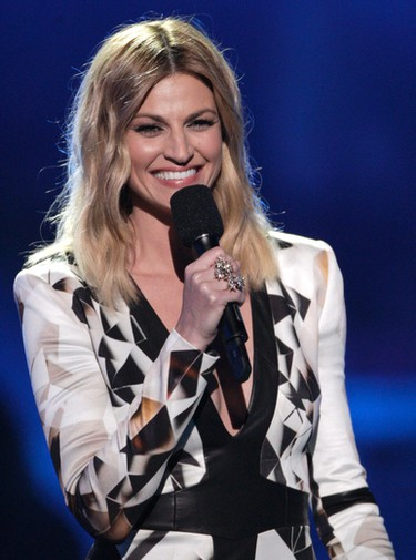 Host Erin Andrews speaks on stage  at the CMT Music Awards at the Bridgestone Arena on Wednesday, June 8, 2016, in Nashville, Tenn. (Photo by Wade Payne/Invision/AP)