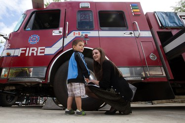 Luke Kovacic, 2, and his aunt Celine Erickson look at a fire truck during First Responders Day in Churchill Square, in Edmonton Alta. on Thursday June 9, 2016. Organizers say the event was an opportunity for the public to meet first responder members outside of an emergency situation. Photo by David Bloom