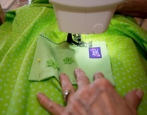Madeline Twerdochlib of Spruce Grove participates in a local sewing bee to help make dresses for impoverished girls in other countries, on Saturday, June 4, 2016.  - Photo by Yasmin Mayne
