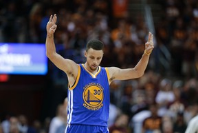 Warriors guard Stephen Curry celebrates a basket against the Cavaliers during the second half of Game 4 of the NBA Finals in Cleveland on Friday, June 10, 2016. (Tony Dejak/AP Photo)