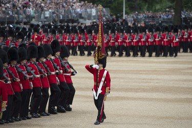 Members of Number 7 Company Coldstream Guards troop the Queen's Colour during the Queen's Birthday Parade, 'Trooping the Colour', in London on June 11, 2016.  Trooping The Colour and the fly-past are part of a weekend of events to celebrate the Queen's 90th birthday. / AFP PHOTO / OLI SCARFF