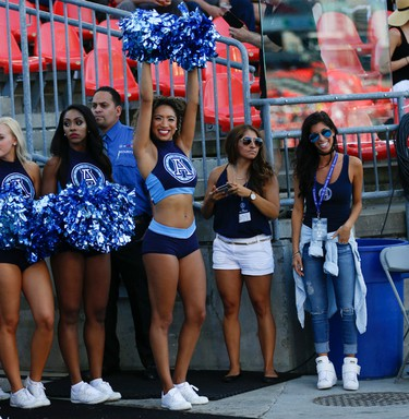 Argos Cheer prepare to hit the field during a break in the during the second quarter pre-season game at BMO Field  Toronto, Ont. on Saturday June 11, 2016. Jack Boland/Toronto Sun/Postmedia Network