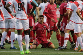 Bryan Olivera of Ottawa Fury FC is surrounded by his teammates and Rayo OKC players after a scoring chance on June 11. (David Kawai)