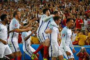 England's Eric Dier, 2nd right, celebrates after scoring the opening goal during the Euro 2016 Group B soccer match between England and Russia, at the Velodrome stadium in Marseille, France, Saturday, June 11, 2016. (AP Photo/Kirsty Wigglesworth)