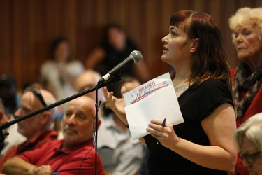 Gabrielle Gillespie, a mother of a toddler, was one for he close to 500 area residents who showed up to a public meeting at Archbishop Romero Catholic S.S. to voice their opinions as the city plans to ram through a 100-bed men's homeless shelter at 731 Runnymede Road - a former Goodwill Site - just south of St. Clair Ave. W. in Ward 11 on Thursday June 9, 2016. Jack Boland/Toronto Sun/Postmedia Network