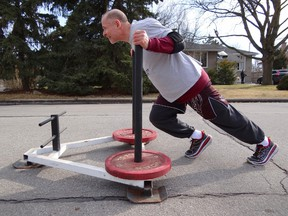 Toronto Police Supt. Heinz Kuck, commander of 11 Division, is preparing to push a weighted sled from his station to the Dovercourt Boys and Girls Club in an effort to raise money for a youth music program. (TRAVIS KUCK PHOTO)