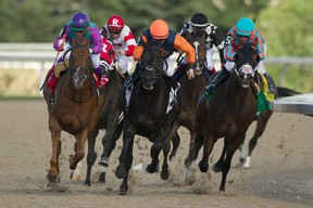 Jockey Luis Contreras (left) guides Ami's Gizmo to victory in the Plate Trial Stakes at Woodbine on Sunday. Contreras nearly won aboard Gamble's Ghost, too. (MICHAEL BURNS/PHOTO)