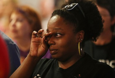 Mourners attend a memorial service at the Joy MCC Church for the victims of the terror attack at the Pulse Nightclub in Orlando, Fla., on June 12, 2016. (Joe Raedle/Getty Images/AFP)