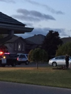 Armed police surround a house in a subdivision just east of Walmart in Quinte West Sunday night.