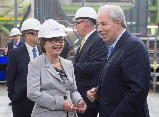 Public Services Minister Judy Foote, left, shares a light moment with Jim Irving, CEO of Irving Shipbuilding, at the Irving Shipbuilding facility in Halifax on Monday, June 13, 2016. THE CANADIAN PRESS/Andrew Vaughan