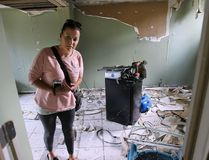 Cassandra Salidas checks out the damage to her Essex, Ont., home on Monday, June 13, 2016. While she was on vacation at Disney World in Florida, her house was broken into and thieves stole items, then trashed the home and left water running for hours. (DAN JANISSE/The Windsor Star/Postmedia Network)