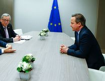 British Prime Minister David Cameron (R) attends a meeting with and European Council President Donald Tusk (L) and European Commission President Jean Claude Juncker (C) during a European Union leaders summit addressing the so-called Brexit on February 19, 2016. YVES HERMAN/AFP/Getty Images
