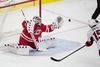 Carolina Hurricanes goalie Cam Ward, left, makes a save on a shot by Ottawa Senators' Zack Smith (15) in the shootout of a game in Raleigh, N.C., Tuesday, March 8, 2016. (AP Photo/Ben McKeown)